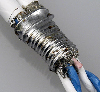 Bare wire, tightly wrapped around braided shielding and then soldered.